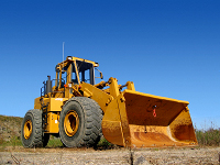 Bulldozer against blue sky